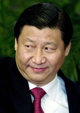 Chinese Vice President Xi Jinping, here in 2007, has been promoted to a key position in the Communist Party's military commission, indicating that he will succeed President Hu Jintao. (Associated Press)