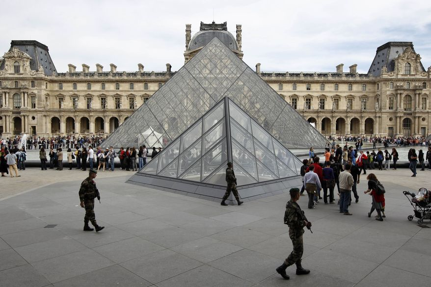** FILE ** French soldiers patrol around the Louvre museum in Paris, Sunday, Oct. 3, 2010, after a terror threat. (AP Photo/Laurent Cipriani)