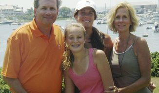 ** FILE ** A June 2007 photo shows Dr. William Petit Jr. (left) with daughters Michaela (front) and Hayley (center rear) and wife Jennifer Hawke-Petit on Cape Cod in Massachusetts. Dr. Petit was severely beaten and his wife and two daughters were killed during a home invasion in Cheshire, Conn., on July 23, 2007. (AP Photo/Courtesy of Dr. William Petit Jr., File)