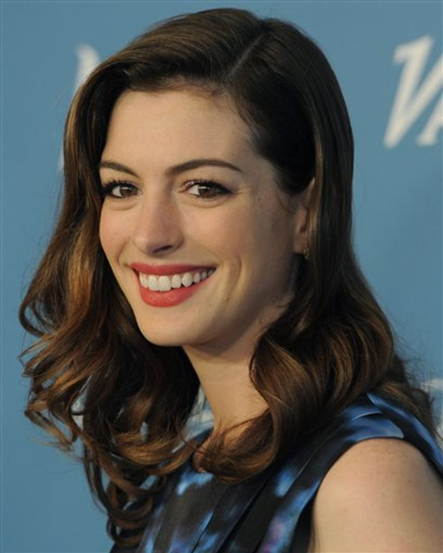 A Sept. 30, 2010 photo shows Anne Hathaway arriving for Variety's 2nd Annual Power of Women Luncheon in Beverly Hills, Calif.  Anne Hathaway is now at a point where she can joke about her former boyfriend admitting he was a con artist.  (AP Photo/Chris Pizzello)
