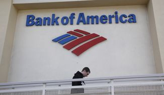 The exterior of Bank of America bank is seen in Palo Alto, Calif., on Monday, Oct. 18, 2010. Bank of America has lost $7.65 billion during the third quarter due to a one-time charge related to credit and debit card reform legislation passed over the summer. (AP Photo/Paul Sakuma)