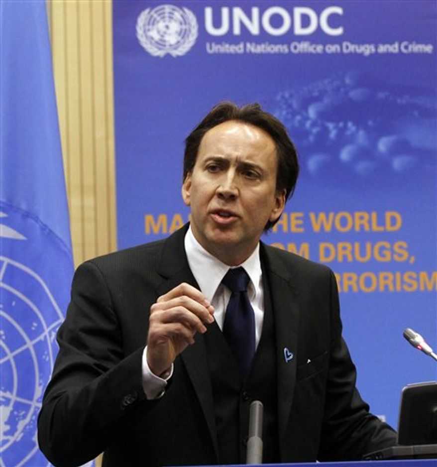 Executive Director from United Nations Office on Drugs and Crime, UNODC, Yury Fedotov speaks with actor and UNODC Goodwill Ambassador Nicolas Cage, from left, at the conference  from United Nations Office on Drugs and Crime, UNODC, on transnational organized crime at the UN headquarters in Vienna, Austria, on Thursday, Oct. 21, 2010.  (AP Photo/Ronald Zak)