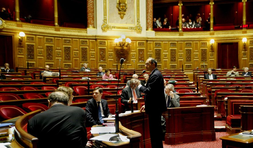 French Labor Minister Eric Woerth delivers his speech on the Pension Reform, at the Senate, in Paris, Friday, Oct. 22, 2010. The Senate later passed the pension reform plan that would raise retirement age to 62 by a 177-153 vote. (AP Photo/Jacques Brinon)