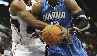 Orlando Magic forward Brandon Bass scores in the first quarter of a preseason NBA basketball game against the Atlanta Hawks on Monday, Oct. 18, 2010, in Atlanta. (AP Photo/John Bazemore)
