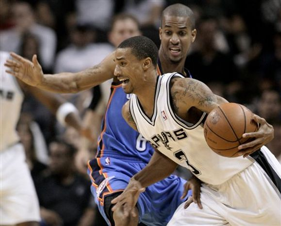 San Antonio Spurs' George Hill, front, drives around Oklahoma City Thunder's Eric Maynor during the second half of a preseason NBA basketball game in San Antonio, Monday, Oct. 18, 2010. Oklahoma City won 111-102. (AP Photo/Darren Abate)