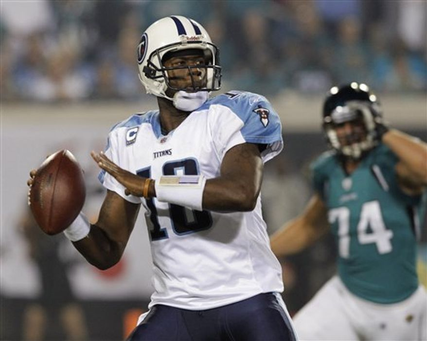 ASSOCIATED PRESS FILE - Tennessee Titans quarterback Vince Young during the first half of an NFL football game against the Jacksonville Jaguars in Jacksonville, Fla., Monday, Oct. 18, 2010.