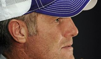 FILE - This Oct. 12, 2010, file photo shows Minnesota Vikings quarterback Brett Favre (4) reacting after failing to get a first down during the fourth quarter or an NFL game against the New York Jets, in East Rutherford, N.J. At left is teammate Eric Frampton (37). The Vikings and Favre have endured plenty of drama already this season with the scandal surrounding Favre and the questions about his health and his performance on the field. (AP Photo/Seth Wenig, File)