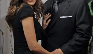 """** FILE ** Celine Dion poses with her husband, Rene Angelil, as they arrive for the premiere of the film """"Celine: Through the Eyes of the World"""" in Miami Beach, Fla., in February 2010. Miss Dion gave birth Saturday to twin boys, just days after being hospitalized as a precaution. (AP Photo/Lynne Sladky, File)"""