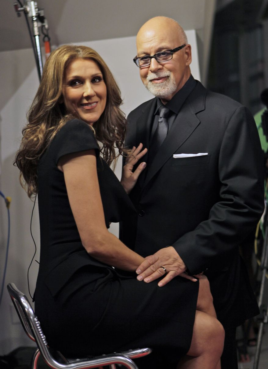 "** FILE ** Celine Dion poses with her husband, Rene Angelil, as they arrive for the premiere of the film ""Celine: Through the Eyes of the World"" in Miami Beach, Fla., in February 2010. Miss Dion gave birth Saturday to twin boys, just days after being hospitalized as a precaution. (AP Photo/Lynne Sladky, File)"