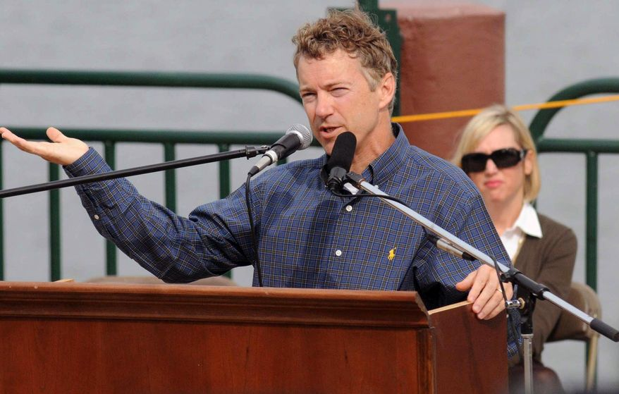 ASSOCIATED PRESS Republican U.S. Senate candidate Rand Paul addresses a large crowd at a Tea Party rally, Saturday, Oct. 23, 2010 on the riverfront in Paducah, Ky. Saturday, Oct. 23, 2010, as his wife Kelley looks on.