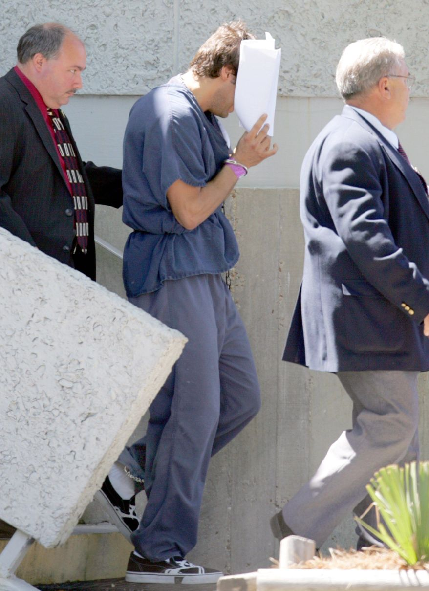 "Seen here in April 2007, ""Girls Gone Wild"" creator Joe Francis uses papers to hide his face as he leaves the U.S. District Courthouse in Panama City, Fla. Francis is facing new legal jeopardy. (Associated Press)"