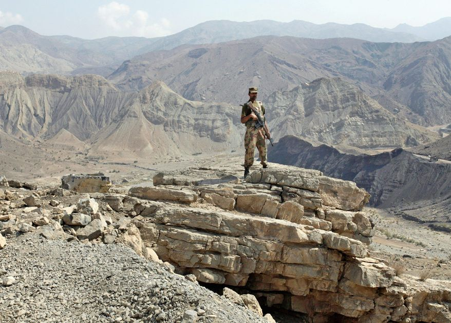 A Pakistani army soldier takes position on a hilltop post in Khajore Kut, an area in South Waziristan. A Pakistani offensive appears to have cleared much of the rugged region of militants, though many have simply fled to other parts of the semiautonomous tribal belt. (Associated Press)