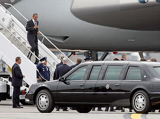 President Barack Obama exits Air Force One at T.F. Green Airport in Warwick, R.I., Monday, Oct. 25, 2010. Obama will tour a factory in Woonsocket, R.I., and attend two fundraisers in Providence, R.I. (AP Photo/Stew Milne)