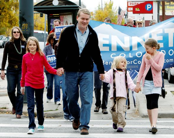 Sen. Michael Bennet, Colorado Democrat, walks with his three daughters to his polling place for early voting on Friday. From left are Caroline, 10; Anne, 5; and Halina, 9. (Associated Press)