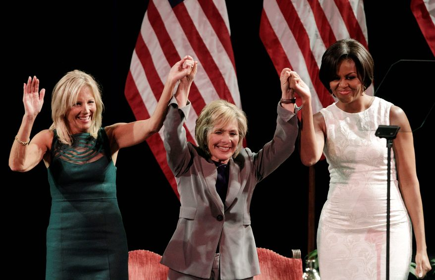"""Jill Biden (left), Sen. Barbara Boxer, California Democrat, and first lady Michelle Obama acknowledge supporters during a fundraiser in Los Angeles on Tuesday. """"California, my husband can't do it alone,"""" Mrs. Obama said of the midterm elections Tuesday while appearing with Mrs. Boxer. (Associated Press)"""