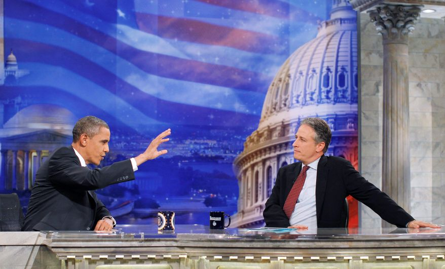 "Associated Press President Obama gestures during a TV commercial break as he chats with host Jon Stewart on a taping of Comedy Central's ""The Daily Show"" Wednesday in Washington."