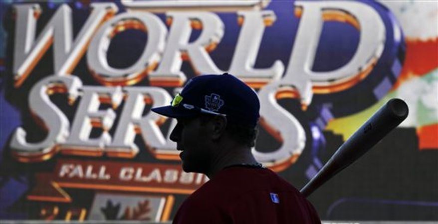 Former San Francisco Giants' Barry Bonds gestures during the fifth inning of Game 1 of baseball's World Series against the Texas Rangers Wednesday, Oct. 27, 2010, in San Francisco. (AP Photo/Marcio Jose Sanchez)