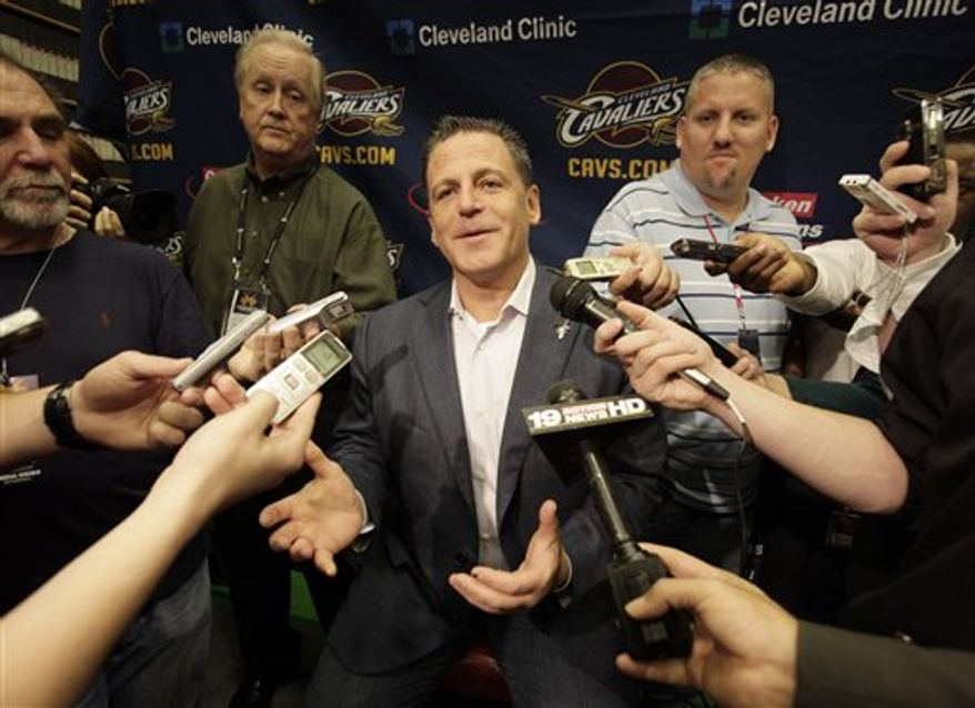 Cleveland Cavaliers owner Dan Gilbert talks with reporters before the Cavaliers' season-opening NBA basketball game against the Boston Celtics on Wednesday, Oct. 27, 2010, in Cleveland. (AP Photo/Amy Sancetta)