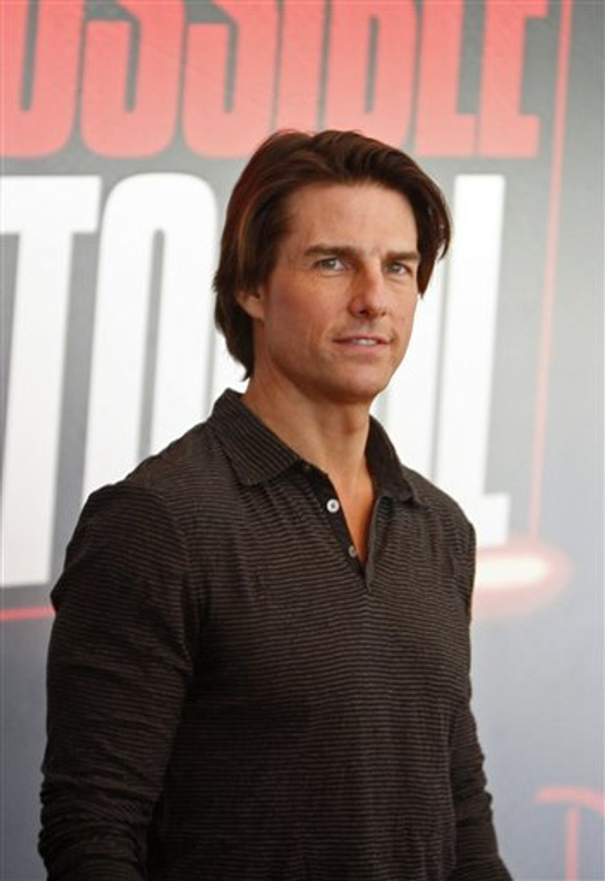 """The crew of the latest """"Mission Impossible"""" attend a press conference in Burj Khalifa  Dubai, United Arab Emirates, Thursday Oct. 28, 2010.  Filming includes shots involving the Burj Khalifa, the world's highest building. The cast, including star Tom Cruise, right, is in Dubai to shoot scenes for the film, which is due out late next year.(AP Photo/Farhad Berahman)"""