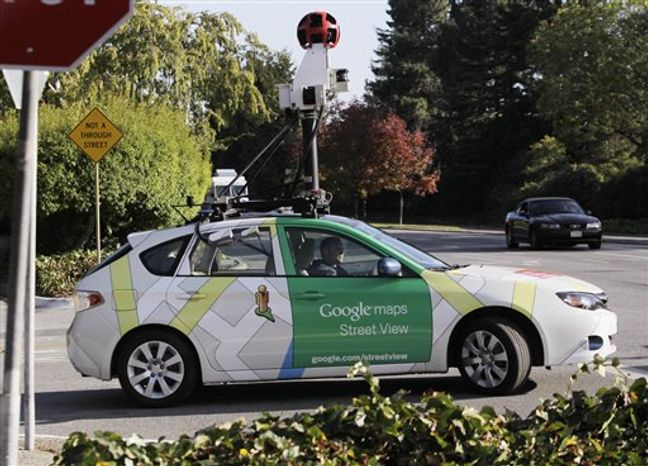 """A Google driver drives with a Google vehicle around Palo Alto, Calif., streets Wednesday, Oct. 27, 2010, to shoot """"Street Views"""". The Federal Trade Commission is scolding Google, but not taking any further action against the company for collecting personal information transmitted over unsecured wireless networks.(AP Photo/Paul Sakuma)"""