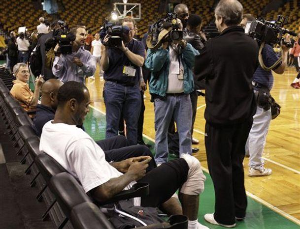 Miami Heat forward LeBron James complains to the referee during the second half of an NBA basketball game against the Boston Celtics in Boston, Sunday, Feb. 13, 2011. The Celtics won 85-82. (AP Photo/Elise Amendola)