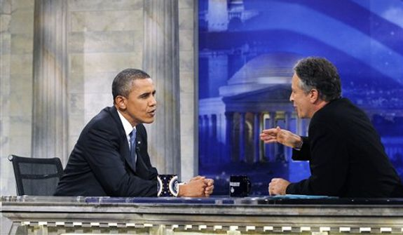 "President Barack Obama is pictured during a commercial break as he talks with host Jon Stewart as he takes part in a taping of Comedy Central's ""The Daily Show,"" Wednesday, Oct. 27, 2010, in Washington. (AP Photo/Charles Dharapak) ** FILE **"