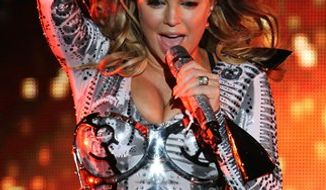 FILE - In this Sept. 30, 2010, file photo, Stacy Ferguson, known as Fergie, of the Black Eyed Peas, performs during a concert in Monterrey, northern Mexico. (AP Photo/Carlos Jasso, file)