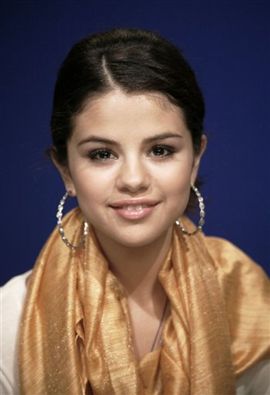 FILE - In this Sept. 23, 2010 file photo, recording artist and actress Selena Gomez poses for a portrait in New York. (AP Photo/Jeff Christensen)
