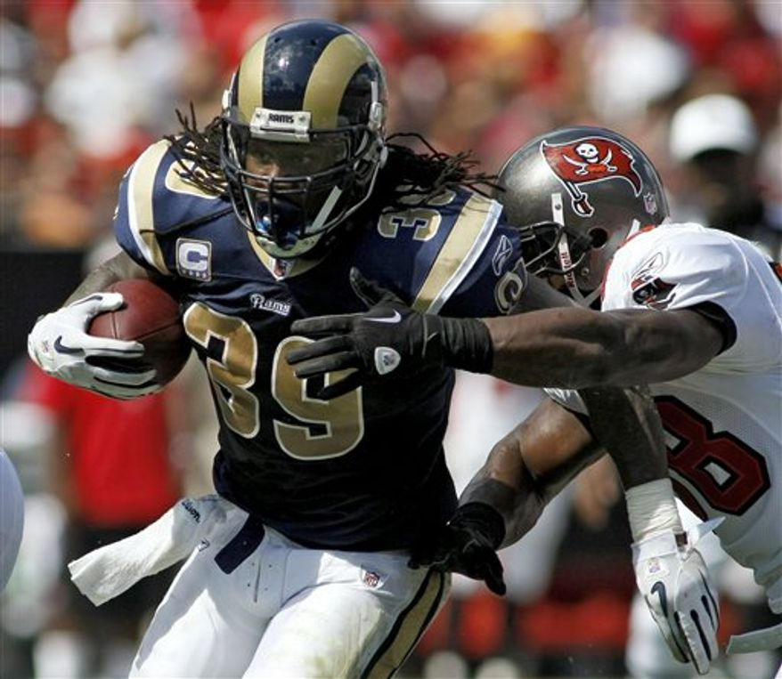 St. Louis Rams running back Steven Jackson (39) leaps over a tackle by Tampa Bay Buccaneers linebacker Geno Hayes (54) during the second quarter of an NFL football game, Sunday, Oct. 24, 2010, in Tampa, Fla. (AP Photo/Chris O'Meara)