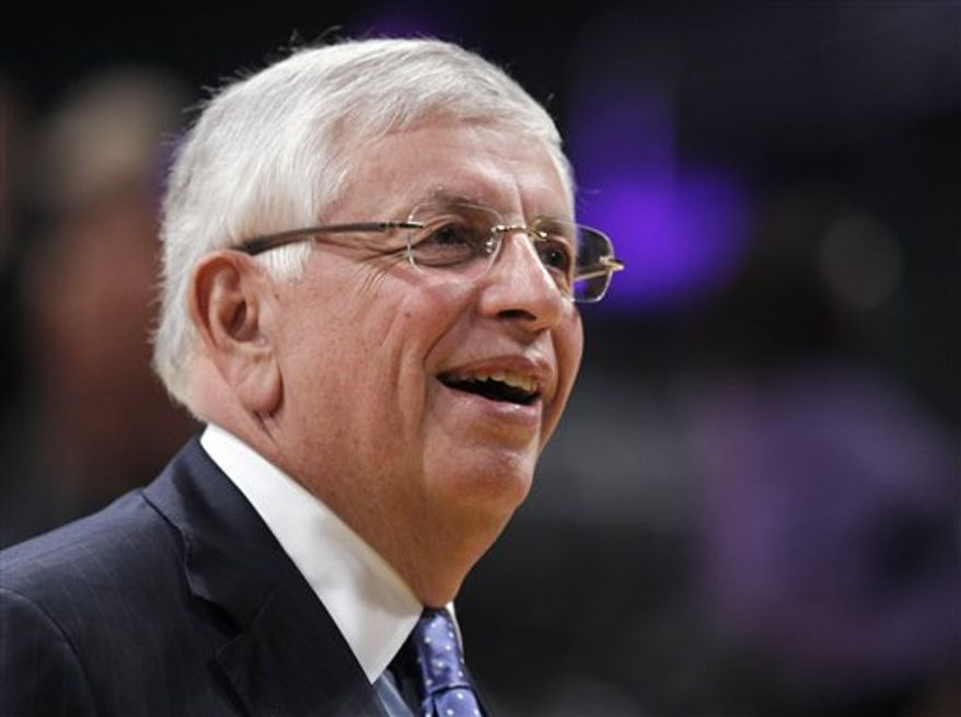 NBA commissioner David Stern walks around the basketball court before the Los Angeles Lakers' home opener basketball game against the Houston Rockets in Los Angeles, Tuesday, Oct. 26, 2010. (AP Photo/Chris Carlson)