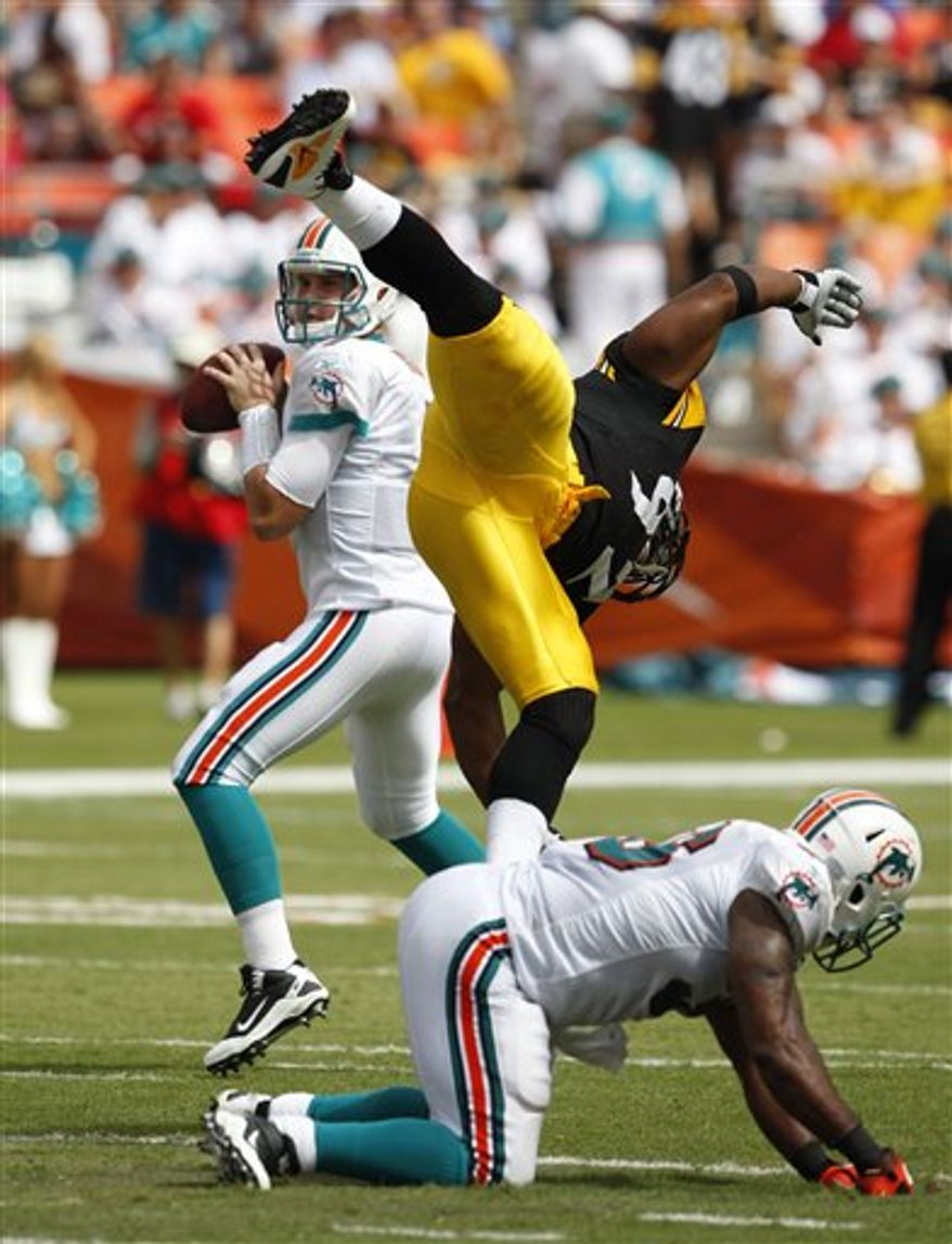 Miami Dolphins linebacker Karlos Dansby (58) lands on the ball fumbled by Pittsburgh Steelers quarterback Ben Roethlisberger in the second half of an NFL football game in Miami, Sunday, Oct. 24, 2010. The Steelers won 23-22. (AP Photo/Alan Diaz)