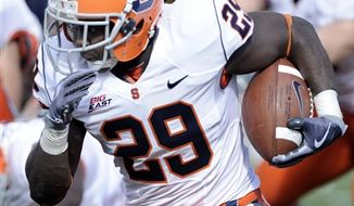 West Virginia's Noel Devine looks for running room past Syracuse's Mike Holmes during an NCAA college football game, Saturday, Oct. 23, 2010, in Morgantown, W.Va. (AP Photo/Jeff Gentner)