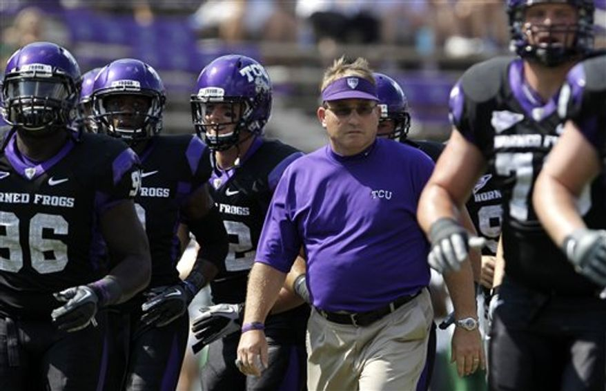 FILE - In this Sept. 18, 2010, file photo, TCU coach Gary Patterson walks off the field with his team before an NCAA college football game against Baylor in Fort Worth, Texas. The fourth-ranked Horned Frogs have seen too many teams get knocked out of the BCS picture after overlooking an opponent in what becomes a classic trap game. Therefore, there hasn't been any talk about the upcoming road game against eighth-ranked Utah. It's all about UNLV. (AP Photo/Tony Gutierrez, File)