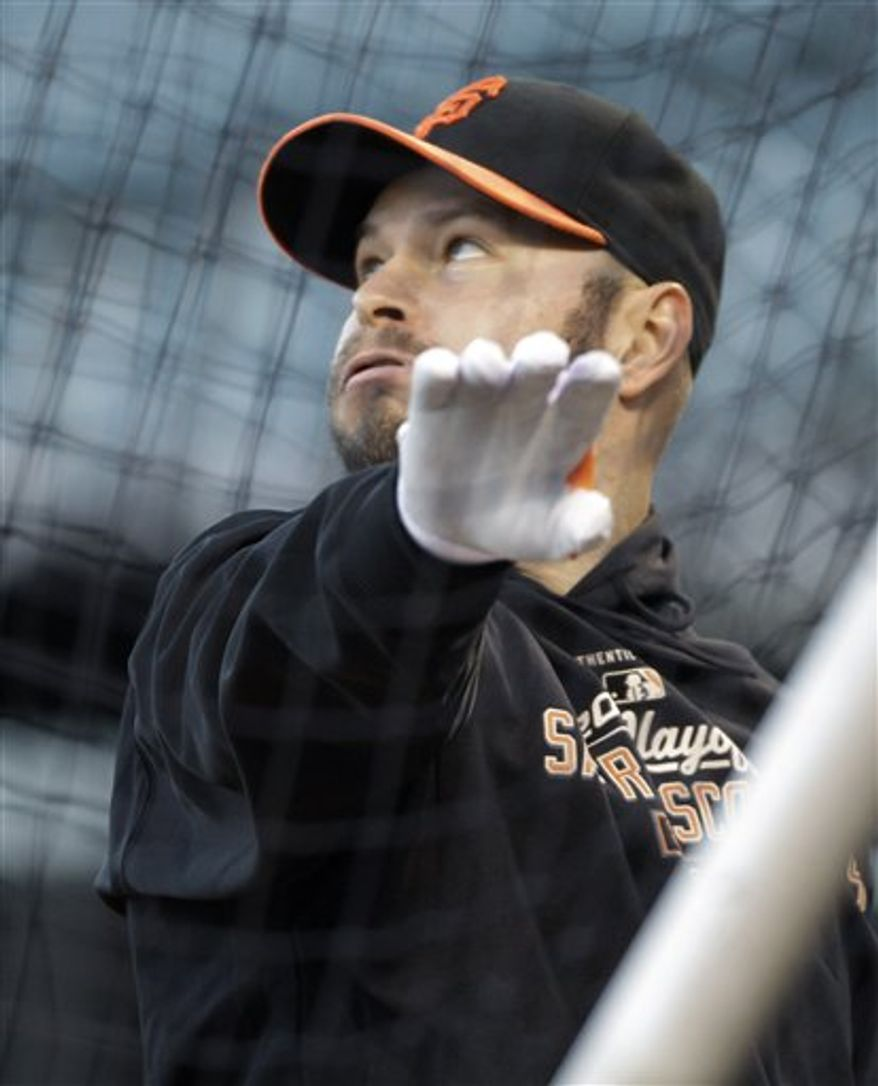 San Francisco Giants' Cody Ross takes batting practice during a baseball workout at AT&T Park in San Francisco, Monday, Oct. 25, 2010. The Giants and the Texas Rangers are scheduled to play Game 1 of the World Series on Wednesday. (AP Photo/Eric Risberg)