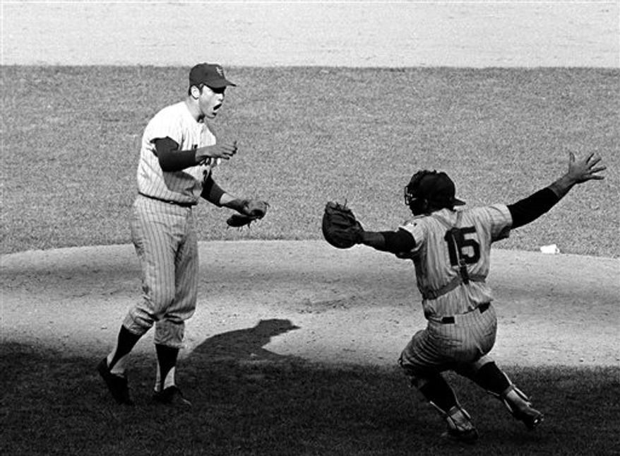 """FILE - This Oct. 6, 1969, file photo shows New York Mets pitcher Nolan Ryan, left, and catcher Jerry Grote celebrating defeating the Atlanta Braves to win the National League pennant, at Shea Stadium in New York. Ryan got to pitch in the World Series only once _ as a 22-year-old for the 1969 New York Mets. Now he is already there as a part-owner of the Texas Rangers, who have definitely been molded by the Hall of Fame pitcher""""s old-school philosophy.  (AP Photo/File)"""