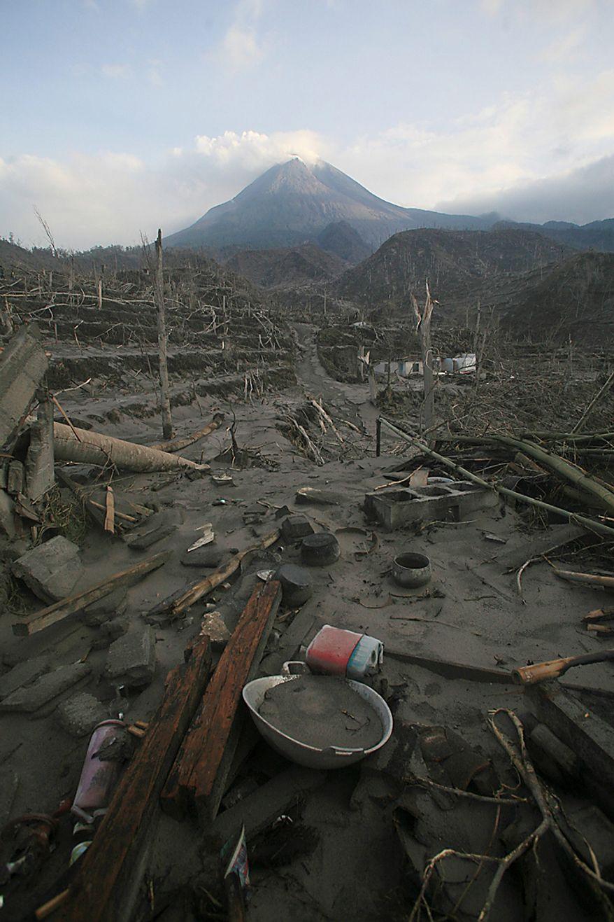 Kitchen utensils lie covered with volcanic ash from Mount Merapi eruption in Kinahrejo village, Yogyakarta, Indonesia, Thursday, Oct. 28, 2010. (AP Photo/Binsar Bakkara)