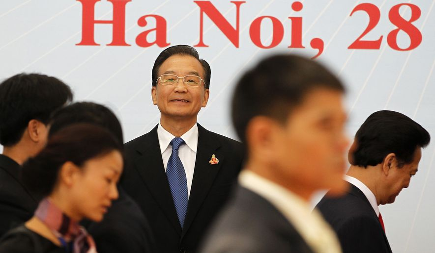 China's Premier Wen Jiabao waits for other leaders to arrive for a family photo during the 17th ASEAN Summit in Hanoi on Saturday, Oct. 30, 2010. (AP Photo/Damir Sagolj, Pool)