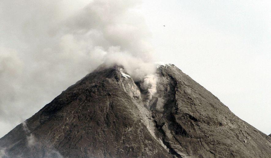 Mount Merapi spews volcanic smoke as seen from Cangkringan, Yogyakarta, Indonesia, Saturday, Oct. 30, 2010. (AP Photo/Irwin Fedriansyah)