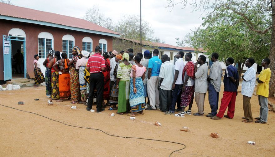 Tanzanians line up to vote in Msoga village on Sunday. Tanzania's ruling party, in power for nearly half a century, is facing a stiff challenge from an energized opposition. (Associated Press)