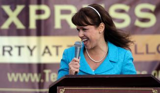 Delaware GOP Senate candidate Christine O'Donnell speaks to a Tea Party Express rally Sunday in Wilmington, Del. (Associated Press)
