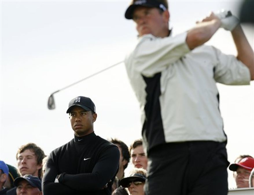 FILE - This file photo of Thursday, July 16, 2009 shows Tiger Woods of the US, left, lining up a putt on the 10th green as Lee Westwood of England, right, looks on, during the opening round of the British Open Golf championship, at the Turnberry golf course, Scotland.  For the first time in more than five years, Tiger Woods is no longer golf's No. 1 player. Lee Westwood of England took the top ranking Sunday Oct. 31, 2010 after PGA champion Martin Kaymer failed to finish among the top two at the Andalucia Masters in Spain. Westwood is the first European since Nick Faldo in 1994 to be No. 1, and the 13th player to be No. 1 since the ranking system began in 1986.(AP Photo/Matt Dunham, file)