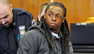 Rapper Lil Wayne is handcuffed at criminal court in New York last March. He was convicted of loaded-gun possession. But with a few days left before he is free, Lil Wayne is an even bigger star because of a new album and his Facebook and blog communications with fans. (Associated Press)