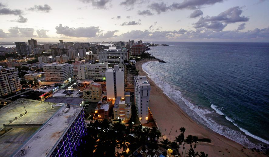 A view from a high-rise in San Juan, Puerto Rico, shows its Atlantic shoreline. Puerto Rico's relationship with the U.S. is confusing to many, including locals. (Associated Press)