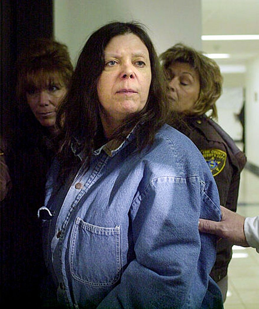Marjorie Diehl-Armstrong, seen here in January 2004 being escorted to court in Erie, Pa., was convicted Monday of participating in a bizarre bank-robbery plot that ended in the death of a pizza-delivery driver in August 2003. Diehl-Armstrong, 61, vowed to appeal the conviction. (Associated Press)
