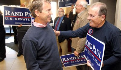 Rand Paul, left, Republican candidate for the U.S. Senate, talks with Paul Kennedy, of Fort Wright, Ky., during a campaign stop at Cincinnati/Northern Kentucky International Airport. (AP Photo/The Enquirer, Patrick Reddy)