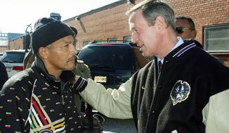 Maryland Gov. Martin O'Malley (right) chats with Theodore McCoy of Baltimore outside Northeast Market in Baltimore on Monday. Mr. O'Malley was in a rematch with Mr. Ehrlich for the governorship. Mr. O'Malley won on Election Night.