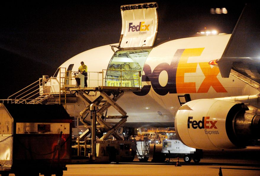 A cargo plane is loaded at the FedEx distribution center in Cologne, Germany, on Monday. Investigators say packages that terrorists in Yemen attempted to smuggle onto an aircraft in an al Qaeda terrorism plot were moved through Cologne. (Associated Press)