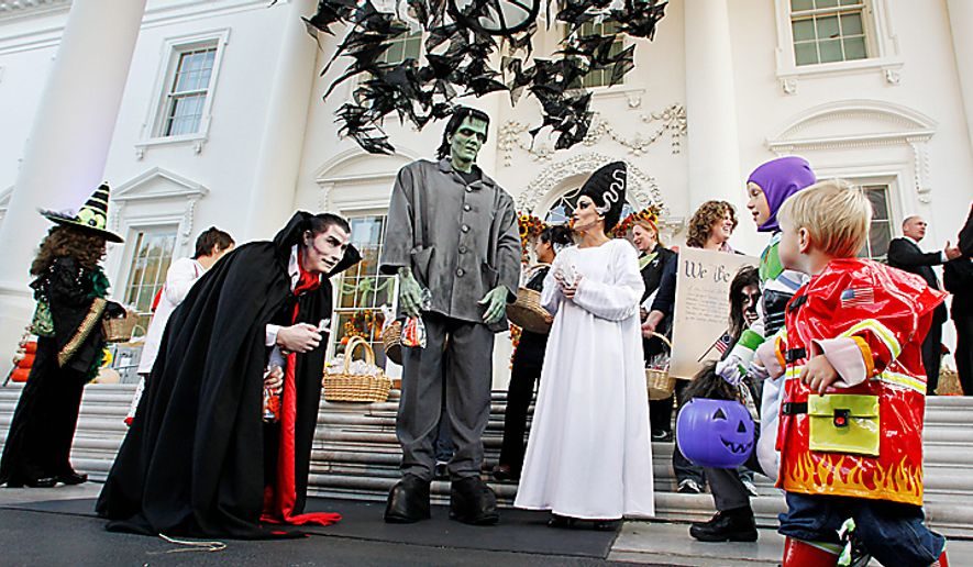 Trick-or-treaters get their treat at the North Portico of the White House during a Halloween celebrations, Sunday, Oct. 31, 2010, in Washington. (AP Photo/Manuel Balce Ceneta) ** FILE **