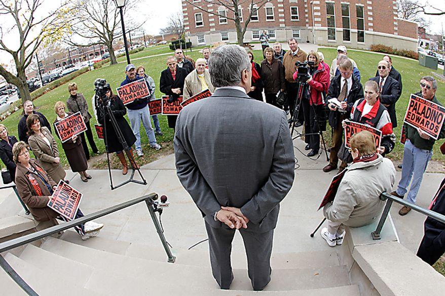 Republican gubernatorial candidate Carl Paladino, back to camera, speaks during a campaign stop, Monday, Nov. 1, 201, in Batavia, N.Y. (AP Photo/David Duprey)