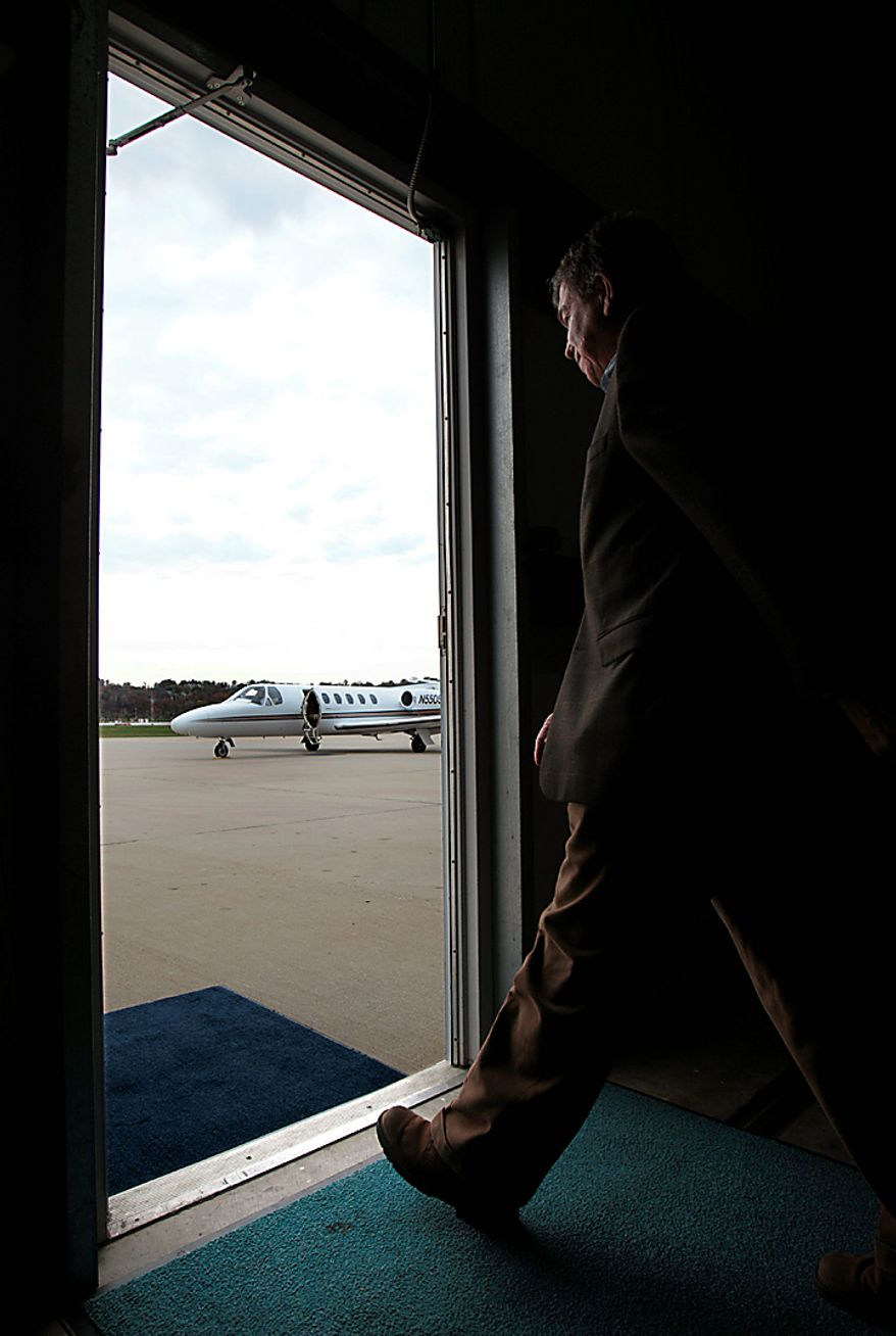 Missouri Republican Senate candidate Roy Blunt walks out of a hanger door to his waiting campaign plane after speaking to supporters during a campaign stop at Spirit of St. Louis Airport Monday, Nov. 1, 2010, in Chesterfield, Mo. Blunt is spending the final day before the election flying around the state meeting with voters. (AP Photo/Jeff Roberson)